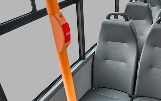 Дополнительная кнопка сигнала об остановке и места с увеличенной шириной для лиц приоритетной категории в салоне ГАЗель Next Автобус